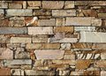 Natural stone wall texture background. These stone bricks range in color from white and pink to brown