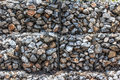 Natural stones in retain A wire mesh gabion wall Royalty Free Stock Photo