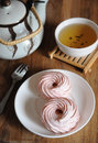 Natural strawberry marshmallow on a white saucer, dessert fork, kettle and bowl with green tea Royalty Free Stock Photo