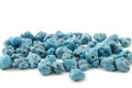 Natural turquoise beads on a white background