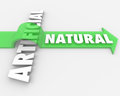 Natural vs unnatural real against fake arrow words the word jumping over the word artificial on an to symbolize the benefits and Stock Image