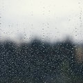 Natural water drops on window glass with green background Royalty Free Stock Photo