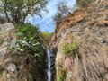 Natural Water fall between mountains on roadside Royalty Free Stock Photo