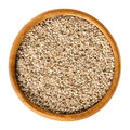 Natural white sesame seeds in wooden bowl over white
