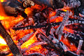 Embers glowing in blazing fire Royalty Free Stock Photo