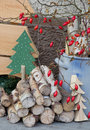 Natural wooden christmas decoration with red rosehips and handmade wood tree Stock Images