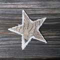 Natural wooden christmas in white and grey star for decoration one Royalty Free Stock Image