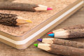 Natural wooden pencils and cork workbook from recycled paper on the desk Stock Photos