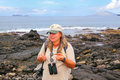 Naturalist guide showing shed shell of Sally lightfoot crab Royalty Free Stock Photo