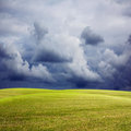 Nature background with green meadow stormy sky and rain spring Royalty Free Stock Photography