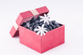 Nature gift box with black zen stones and white Jasmine flowers Stock Image