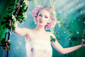 Nature green beautiful young woman standing under an arch of flowers and overgrown loach magic of the spring Stock Image