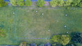 Nature and landscape: Aerial view of a field, plowed field, cultivation, green grass, haystacks, hay bales Royalty Free Stock Photo