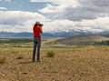 Nature photographer girl portrait of woman taking landscape pictures in the mountain area altai russia Royalty Free Stock Image