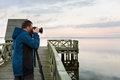 Nature photographer taking photos of the lake at sunset Royalty Free Stock Photo