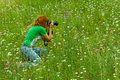 Nature photographer woman portrait of taking pictures of plants and flowers on a meadow altai region russia green colors Royalty Free Stock Photos