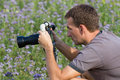 Nature photographer at work man takes off video in a garden through a stabilizator Stock Photos
