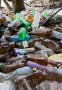 Nature pollution of plastic bottles polluted by waste filth biohazard environmental disaster Stock Images
