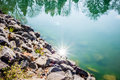Nature reflections in town lake Royalty Free Stock Photo