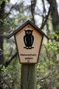 Nature reserve in germany sign at kieshofer moor mecklenburg vorpommern the owl pentagon is one of the official signs indicating a Royalty Free Stock Images