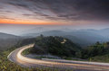 Nature sunrise background amazing curve road and twilight color long exposure view. Popular travel Mountain in Thailand
