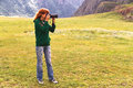 Nature woman photographer portrait of taking landscape pictures in the mountain area altai russia Royalty Free Stock Image