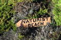 Naturist beach sign lost in the middle of the vegetation Stock Image