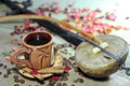 Naturmort with cup of coffee coffee beans and musical instrume still life ceramic egyptian instrument grains on background petals Royalty Free Stock Images
