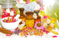 Naturopathy and aromatherapy still life with a pestle mortar alongside fresh dried flowers floral potpourri essential Stock Photos