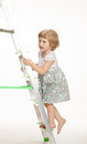 The naughty little girl walking down the stepladder on white background Royalty Free Stock Images