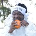 Naughty Santa Eating A Pumpkin Royalty Free Stock Photo
