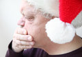 Nauseated senior in holiday hat older man has reaction to rich food and drink Stock Images