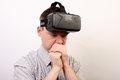 A nauseous dizzy disturbed man wearing oculus rift vr virtual reality headset after a negative experience hes impressed with the Stock Photo