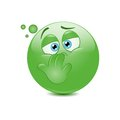 Nauseous emoticon on a white background Stock Images