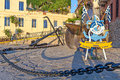 Nautic statue in chania greece july a big anchor and the city centre of Stock Images