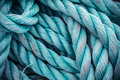 Nautical background closeup of an old blue frayed boat rope tonned image Royalty Free Stock Photo