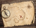 Nautical compass on table with old treasure map 3d illustration Royalty Free Stock Photo