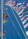 Nautical Flags Flying Against a Blue Sky Royalty Free Stock Photo