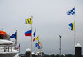 Nautical flags in harbor colorful a under cloudy skies Royalty Free Stock Image