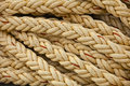 Nautical knots. Big marine vintage sea ropes in heap background Royalty Free Stock Photo