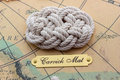 Nautical knots with golden plate Royalty Free Stock Photo