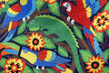 Navajo quilt colorful parrots toucans iguanas and flowers in this Stock Images