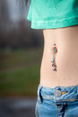 Navel piercing close up Royalty Free Stock Photo