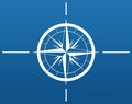 The navigation illustration of a white compass on a blue background Stock Images