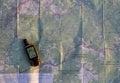 Navigator on paper map Royalty Free Stock Photo