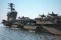 Navy aircraft carrier with a compartment of aircraft and crew.