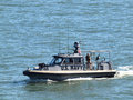 NAVY Boat with soldier standing on deck patrol area Royalty Free Stock Photo