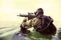 Navy seal frogman with complete diving gear and weapons in the water Stock Images