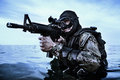 Navy seal frogman with complete diving gear and weapons in the water Stock Photography