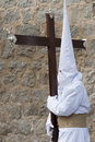 Nazarene carrying a heavy cross. Stock Photo